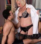 Naughty over 60 MILF Scarlet Andrews appears in black underwear and stockings