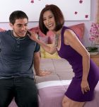 Oriental lady over 60 Kim Anh strips down to white underwear to ride young stud