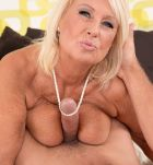 Sexy MILF on the other side of 60 Regi is ready for sex in hot lingerie and stockings