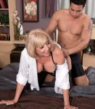 Buxom sandy-haired 60 plus MILF Scarlet Andrews having nips slurped and taunted