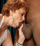 Red hair grannie XXX pornstar Valerie sucking off a humungous black sausage in white lingerie