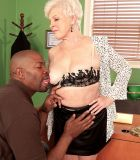 Over Sixty MILF whipping out large granny knockers before interracial sex in office place with BIG EBONY COCK