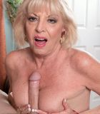 Stocking garmented yellow-haired MILF over Sixty Scarlet Andrews boob boinking hefty pecker