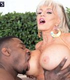 Sex grandma Sally D'Angelo and her enormous hooters take on a BIG EBONY COCK outdoors in a Jacuzzi