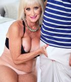 MILF Over 60 Leah L'Amour has sex with a younger man while her hubby sleeps