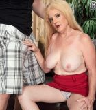 Elderly platinum-blonde broad Charlie has her huge boobies unveiled by younger boy in a red mini-skirt