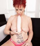 Ginger-haired granny Caroline Hamsel deepthroats a bevy of sex toys in undies
