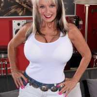 Buxom granny over 60 Sally D'Angelo has a large set of tits indeed