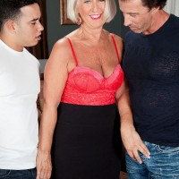 Granny pornstar Jeannie Lou jerking off two dicks at once in pantyhose