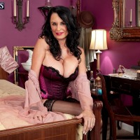 Hot brunette MILF over 60 Rita Daniels posing in sexy black stockings