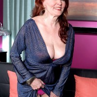 Redheaded mature pornstar Katherine Merlot flashing panties underneath dress