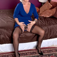 MILF over 60 Jeannie Lou parts stocking clad legs to expose crotchless panties