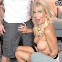 Leggy blonde mom over 60 Erica Lauren freeing large natural tits before oral sex