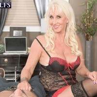 Lingerie and stocking attired MILF over 60 Madison Milstar jerking off cock