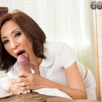 Asian MILF over 60 Kim Anh baring big tits while riding on top of large cock