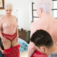 Short haired granny pornstar Jewel exposing mature tits in hose before giving bj