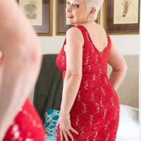 MILF over 60 Jewel posing in front of mirror in pantyhose and red lingerie