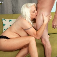 Chunky mature MILF with great legs in high heels riding on top of younger man