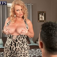 Busty blonde granny Alice playing with big natural mature juggs while giving bj