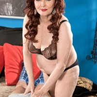 Mature redheaded grandmother Katherine Merlot giving a bj in bra and panties