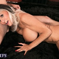 Buxom MILF over 60 Sally D'Angelo getting naked and giving a blowjob