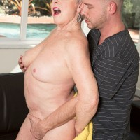 Short haired MILF over 60 Jewel loosing large granny pornstar tits from bikini outdoors