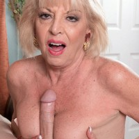 Stocking and lingerie attired MILF over 60 Scarlet Andrews tit fucking long cock