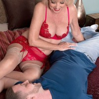 Sexy MILF over 60 Scarlet Andrews giving tit fuck in lingerie and pantyhose