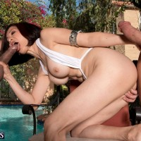 Asian MILF pornstar over 60 Kim Anh exposing big tits outdoors before MMF 3some