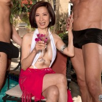 Sexy Asian MILF over 60 Kim Anh posing in revealing bathing suit outdoors