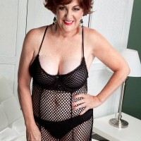 Leggy MILF over 60 Gabriella LaMay freeing large tits from mesh bodystocking