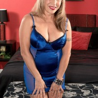Busty blonde MILF over 60 Luna Azul freeing large tits during MMF threesome