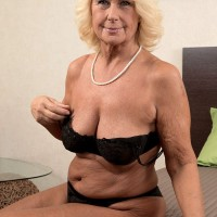 Blonde MILF over 60 Regi stripping off skirt and nylons for hot oil massage