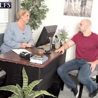 Older blonde GILF in nylons seduces younger man for sex in office