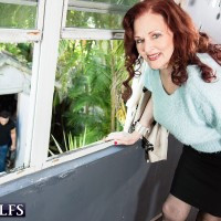 Redheaded MILF over 60 Katherine Merlot flashing large mature tits outdoors