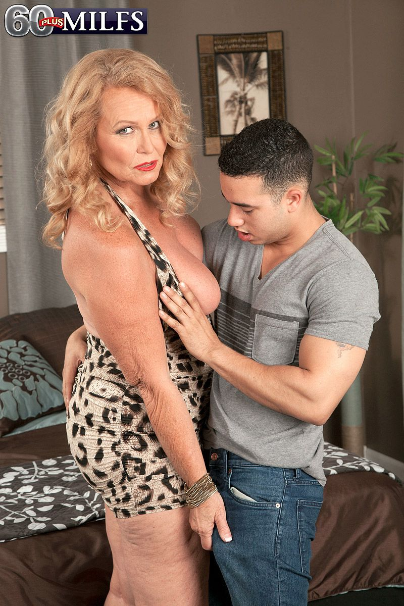 Busty blonde MILF over 60 flashing big mature boobs to seduce younger cock