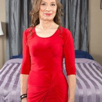 Over 60 MILF in red dress and pantyhose is seduced by younger man for sex