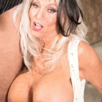Naughty over 60 mommy flashing upskirt panties before fucking younger man
