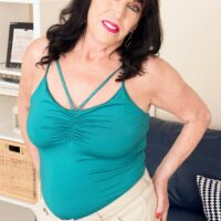 60 plus MILF Christina Starr exposes her sagging breasts as she gets buck naked