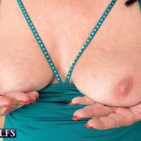 60 plus MILF Christina Starr unveils her sagging titties as she gets totally nude