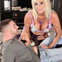 Ash-blonde grandma Leah L'Amour gives her man toy a hand-job in lingerie and nylons