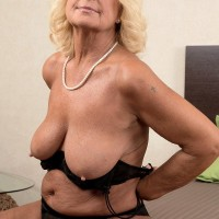 Ash-blonde grandmother Regi letting floppy loose from brassiere before oil massage from massagist