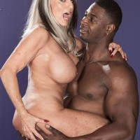 Bosomy 60 plus X-rated actress Sally D'Angelo gets poked by a younger black boy