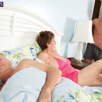 Chesty ginger-haired grannie Bea Cummins jacking off large junk while cuck husband sleeps