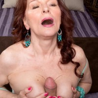 Chesty ginger-haired MILF over 60 Katherine Merlot delivering humungous pecker tit job in tights