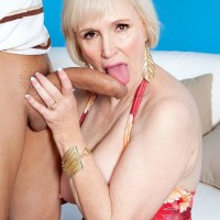 Chesty short haired granny Lola Lee giving immense knob blow job and tit-fucking in tights