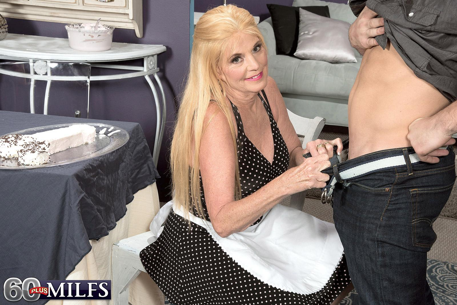Dressed ash-blonde over Sixty MILF Charlie giving CFNM handjob to immense penis
