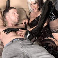 Enormous jugged Sixty plus MILF Sally D'Angelo jerks a dick in latex boots and ebony corset