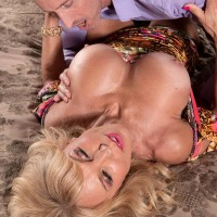 Experienced blonde babe Cara Reid releasing nice breasts for slurping of X-rated star nipples