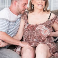 Experienced doll Crystal King has her hefty melons played with by a younger guy